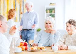 elderly people having a meal