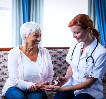 nurse checking the elder woman